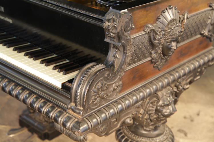 Ornately carved piano cheeks