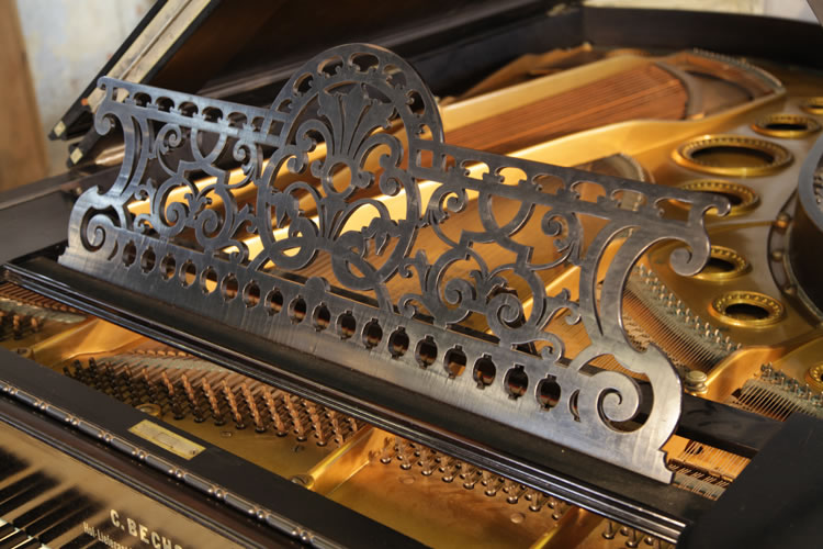 The filigree music desk on this Bechstein model C include cut-out anthemions and arabesques