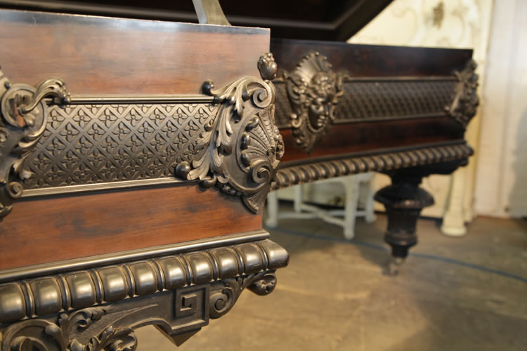 Carved detail aroud piano cabinet