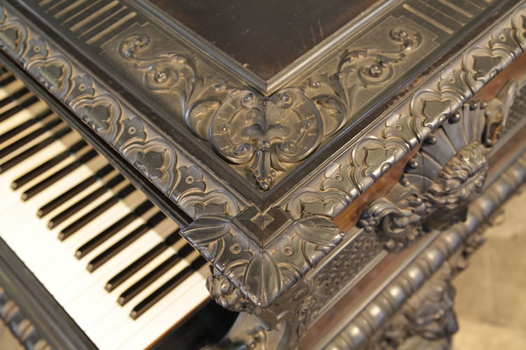 Ornately carved piano lid
