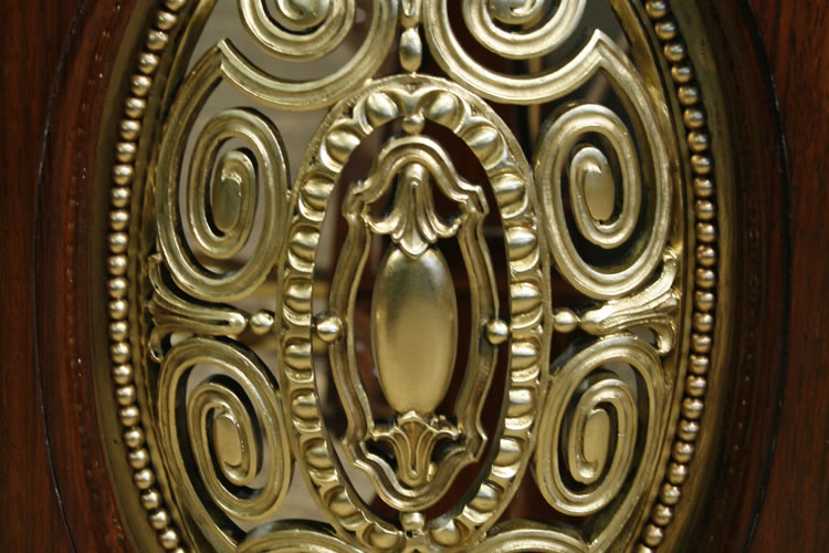 Oval piano legs feature ornate filigree bronze panels