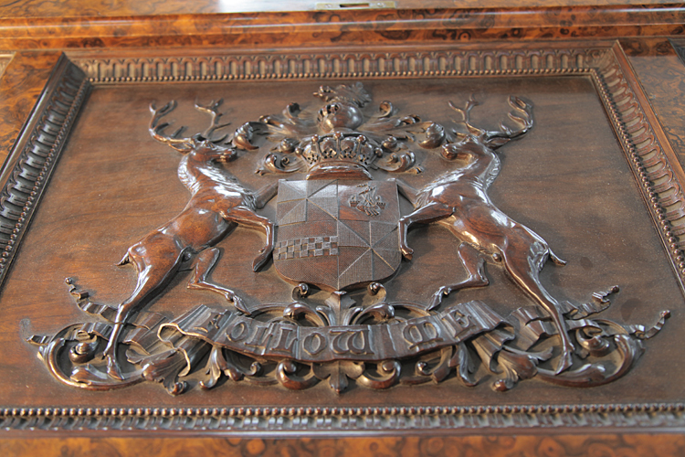Carved coat-of-arms of the Earl of Breadalbane on the underside of the piano lid