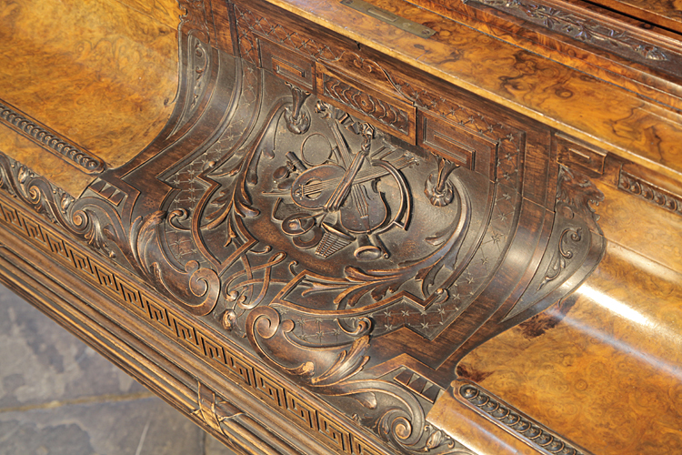 Collard and Collard piano fall carved with musical instruments and scrolling arabesques