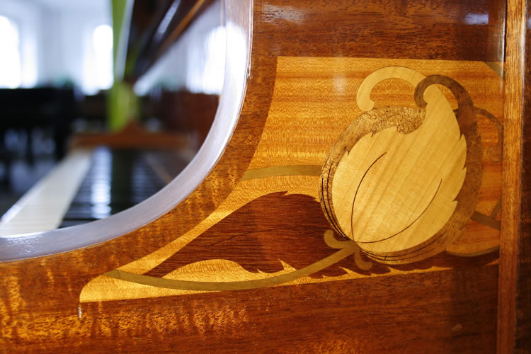 Piano cheek inlaid panel of stylised flowers, leaves and stems in a variety ofcontrasting, exotic woods