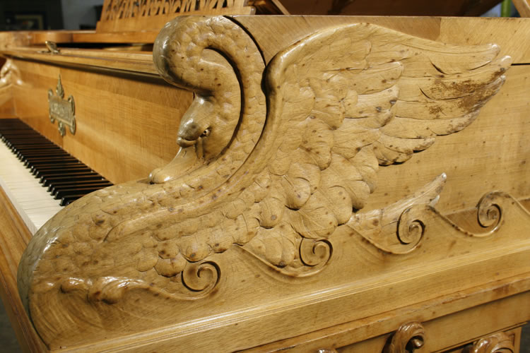 Carved swans on piano cheeks