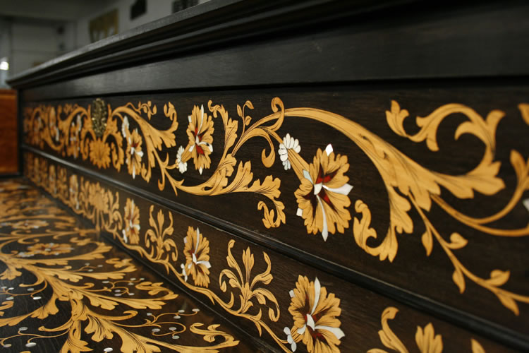 Magnificent scrolling inlay of foliage and hibiscus flowers