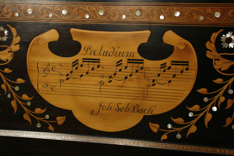 Pelta shields inlaid with part-scores