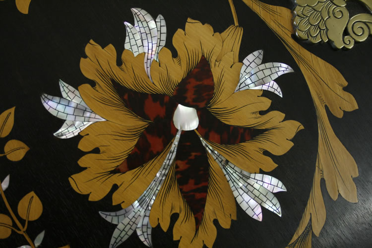 Detail of an inlaid hibiscus flower