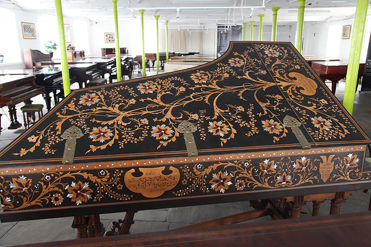 The entire cabinet of this Broadwood grand piano is intricately inlaid