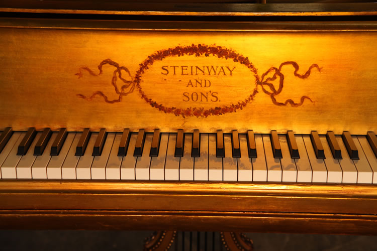 Steinway name on piano fall