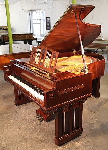 The Golden Age of Pianos. A 1916, German Arts and Crafts, Ibach grand piano for sale with a mahogany case and minimal carved panel detail
