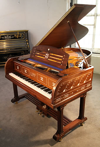 The Golden Age of Pianos. An Arts and Crafts, Lipp grand piano for sale with a mahogany case inlaid with designs from Germanic folklore