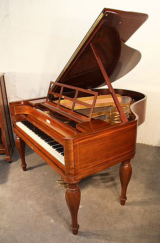 The Golden Age of Pianos. A Biedermeier style, 1926, Steinway Model M grand piano for sale with a french polished, mahogany case, stringing inlay and five baluster legs